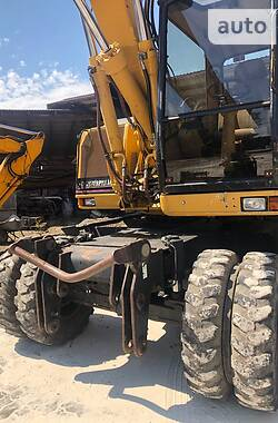 Колесный экскаватор Caterpillar 315 2002 в Калуше