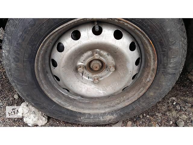 продам Б/у диск с шиной для универсала Peugeot 306 бу в Ровно
