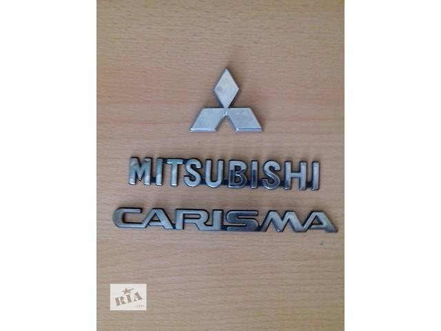 продам Б/у эмблема для легкового авто Mitsubishi Carisma бу в Ковеле
