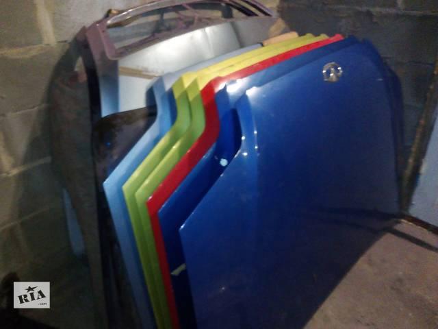 бу Б/у капот для легкового авто Chevrolet Aveo T200 в Остроге