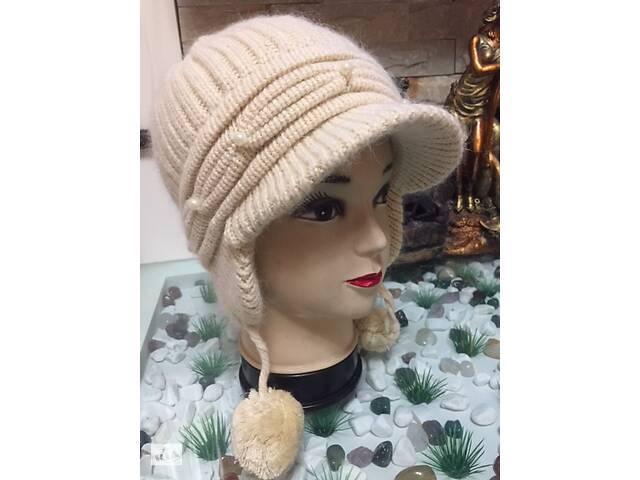 Молодежная женская шапка-ушанкавязаннаяс козырьком, размер 55-57