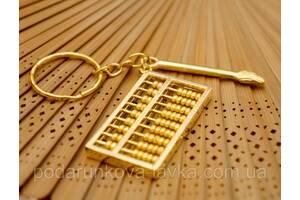 9180025 Брелок в золотом цвете Счёты