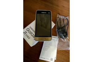 Новые Сенсорные мобильные телефоны Samsung Samsung Galaxy J1 Mini SM-J105F