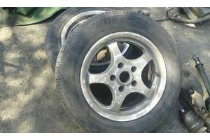 б/у диски с шинами Nissan Almera