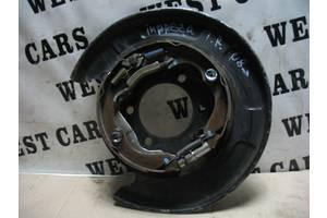 Б/У Механізм ручного гальма правий Impreza 2007 - 2011 26704FG000. Вперед за покупками!